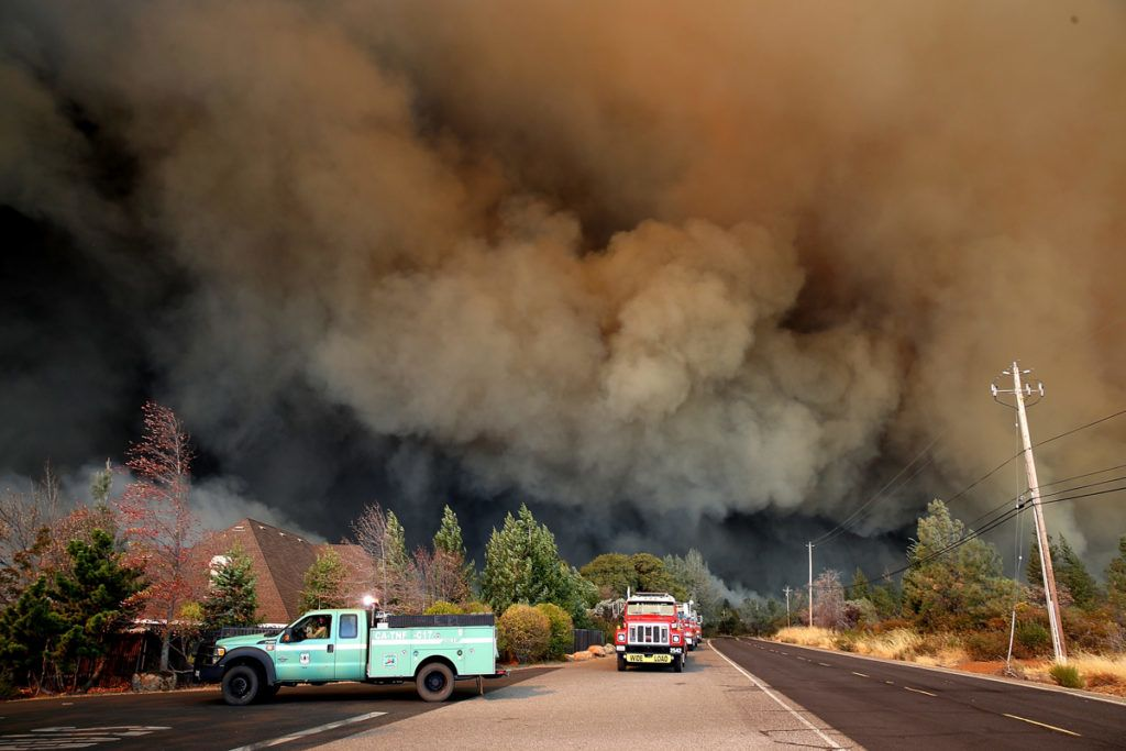 PARADISE, CA - NOVEMBER 08: A plume of smoke rises above the Camp Fire as it moves through the area on November 8, 2018 in Paradise, California. Fueled by high winds and low humidity, the rapidly spreading Camp Fire has ripped through the town of Paradise and has quickly charred 18,000 acres and has destroyed dozens of homes in a matter of hours. The fire is currently at zero containment.   Justin Sullivan/Getty Images/AFP