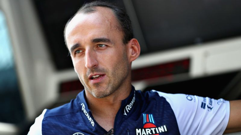 MONZA, ITALY - AUGUST 30:  Robert Kubica of Poland and Williams talks on the pit wall during previews ahead of the Formula One Grand Prix of Italy at Autodromo di Monza on August 30, 2018 in Monza, Italy.  (Photo by Mark Thompson/Getty Images)