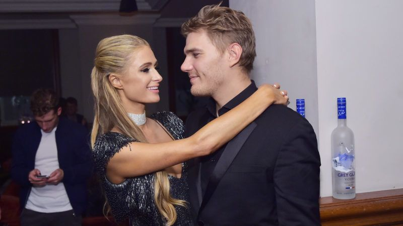 """TORONTO, ON - SEPTEMBER 10:  Paris Hilton (L) and Chris Zylka at """"THE DEATH AND LIFE OF JOHN F. DONOVAN"""" premiere party hosted by GREY GOOSE Vodka and Soho House at Soho House Toronto on September 10, 2018 in Toronto, Canada.  (Photo by Stefanie Keenan/Getty Images for Grey Goose)"""