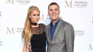 """LOS ANGELES, CA - OCTOBER 11:  Paris Hilton and Chris Zylka attend the ViP Opening of Maddox Gallery Exhibition """"Best Of British"""" at Maddox Gallery on October 11, 2018 in Los Angeles, California.  (Photo by Gregg DeGuire/Getty Images)"""
