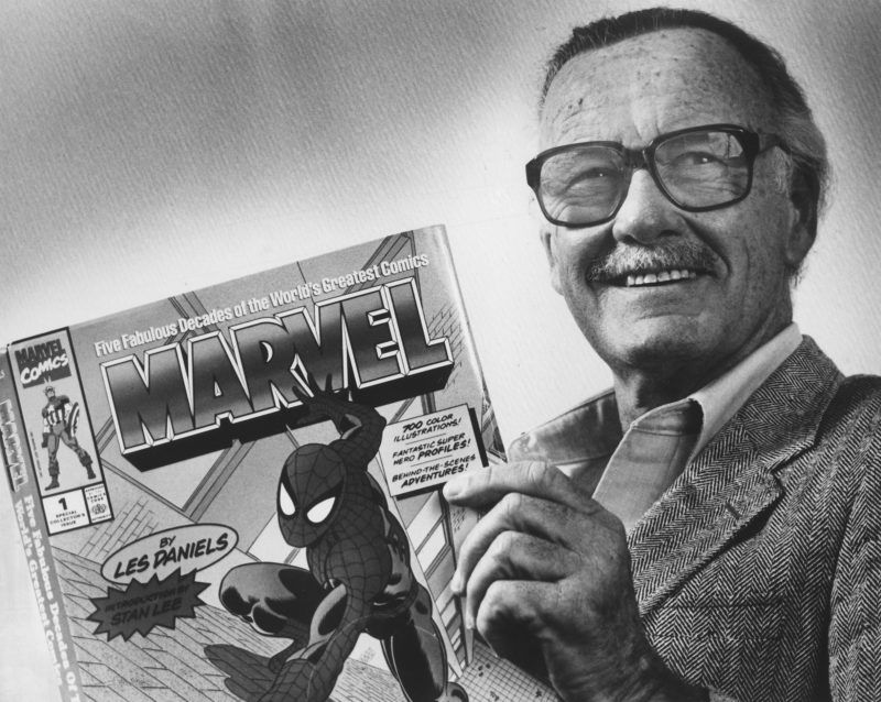 """UNKNOWN LOCATION, DC - FEBRUARY 17: Marvel Comics Publisher, Stan Lee, poses with a book of """"Spider Man"""" comics which he created along with comics on the """"Hulk"""" and others. Photo from Washington Post Archive scanned on 2/17/2009. (Photo by Gerald Martineau/The Washington Post via Getty Images)"""