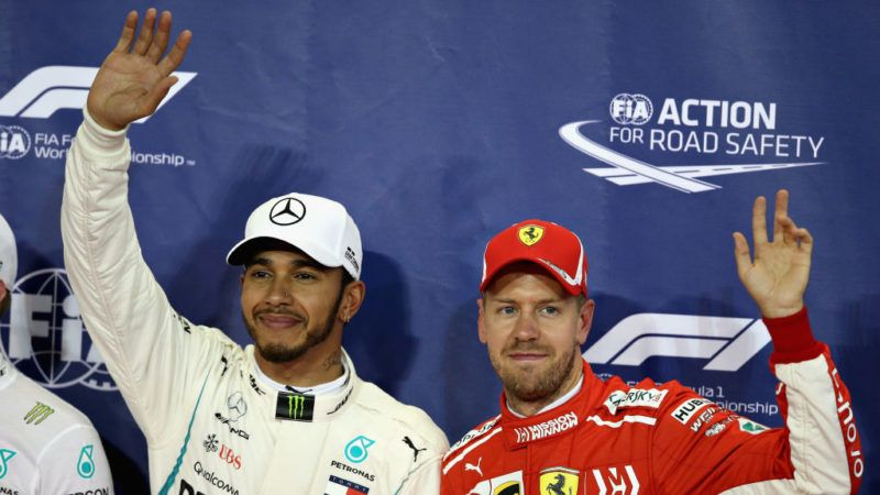 ABU DHABI, UNITED ARAB EMIRATES - NOVEMBER 24: Pole position qualifier Lewis Hamilton of Great Britain and Mercedes GP and third place qualifier Sebastian Vettel of Germany and Ferrari celebrate in parc ferme during qualifying for the Abu Dhabi Formula One Grand Prix at Yas Marina Circuit on November 24, 2018 in Abu Dhabi, United Arab Emirates.  (Photo by Charles Coates/Getty Images)