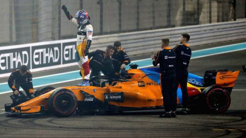 ABU DHABI, UNITED ARAB EMIRATES - NOVEMBER 25: Fernando Alonso of Spain and McLaren F1 waves to the crowd from his car during the Abu Dhabi Formula One Grand Prix at Yas Marina Circuit on November 25, 2018 in Abu Dhabi, United Arab Emirates.  (Photo by Mark Thompson/Getty Images)