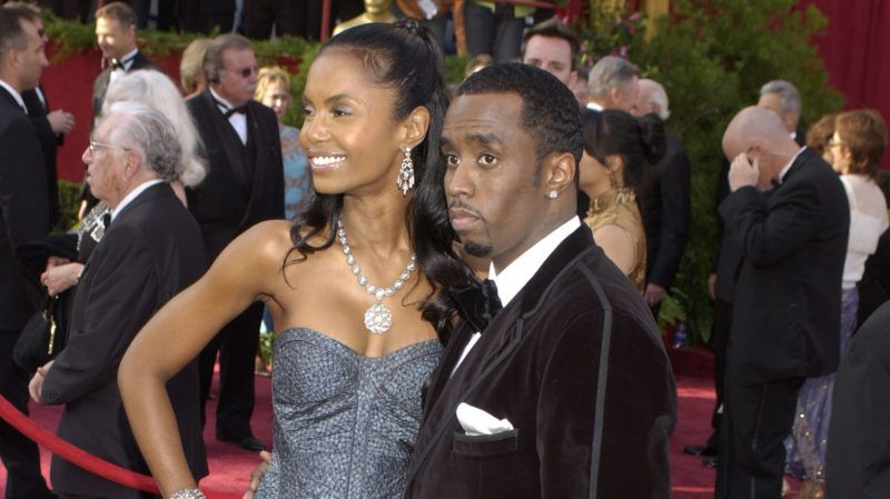 """Sean """"P. Diddy"""" Combs (R) and girlfriend Kim Porter arrive at the 77th Annual Academy Awards at the Kodak Theatre (Photo by Frank Trapper/Corbis via Getty Images)"""