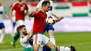 BUDAPEST, HUNGARY - OCTOBER 10: Rogvi Baldvinsson (L) of Faroe Islands slide tackles Roland Ugrai (R) of Hungary during the FIFA 2018 World Cup Qualifier match between Hungary and Faroe Islands at Groupama Arena on October 10, 2017 in Budapest, Hungary. (Photo by Laszlo Szirtesi/Getty Images)