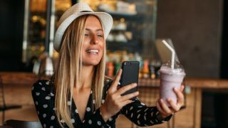 Blogger Woman Takes Milkshake Photo