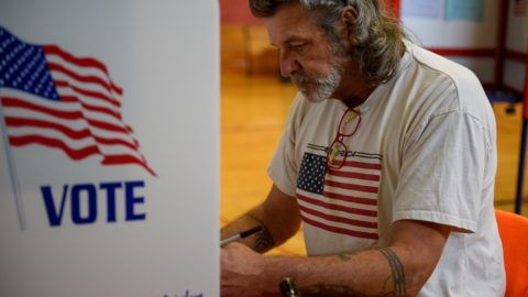 KENT, OH - NOVEMBER 06: Frank Wembling, 62, casts his ballot at the Franklin Elementary School on November 6, 2018 in Kent, Ohio. Turnout is expected to be high nationwide as Democrats hope to take back control of at least one chamber of Congress. Jeff Swensen/Getty Images/AFP