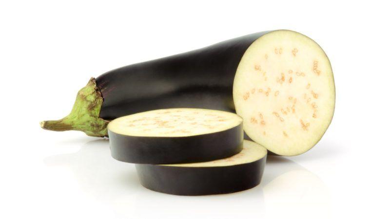Fresh Eggplant and slices isolated on white background