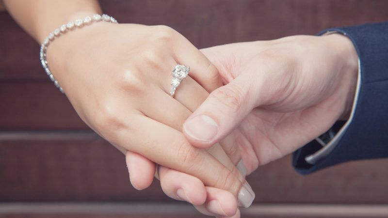 holding hand with diamond ring, wedding proposal