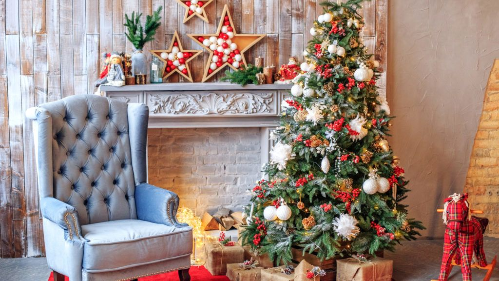 The unusual interior of the living room in the loft is decorated with a Christmas tree. Concept of Happy Christmas, New Year, holiday, background.