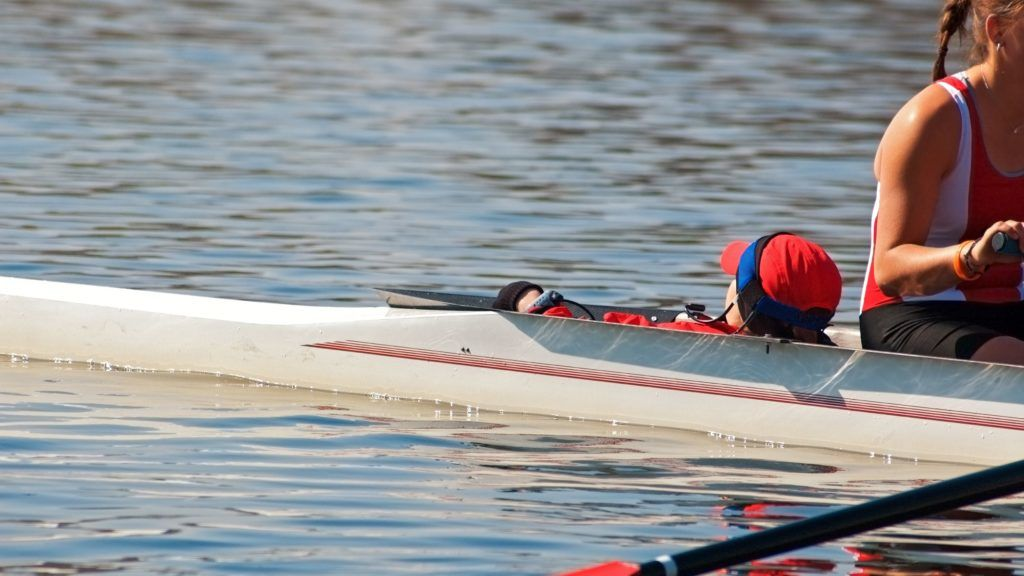 Four oar sweep boat coxswain waits for race start