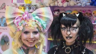 *** EXCLUSIVE - VIDEO AVAILABLE ***  LONDON, UNITED KINGDOM - OCTOBER 2018: Jude (right) and Rosie (left) photographed inside Rosie's room, taken in London, England October 2018.  TWO BRITISH girls are the most unlikely best friends as one is a goth, and the other a pastel lolita. Rosie Hinton, 21, is a pastel-coloured ?80?s space baby? living in London with her best friend, and goth, Jude. Not only do the pair dress in massively contrasting styles, they have even themed their bedrooms around their unique looks. Rosie?s bedroom is jam-packed with pink toys, happy clowns, and colorful stuffed animals, while Jude has taken the more minimal approach, choosing only black and white decor. And they even share a dressing room which is split entirely down the middle, divided by a sofa which is half pastel pink and half gothic black.  PHOTOGRAPH BY Marcus Hessenberg / Barcroft Images