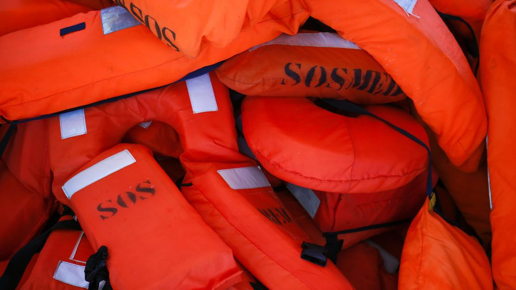 Life vests are pictured at the Aquarius rescue vessel, chartered by French NGO SOS-Mediterranee and Doctors Without Borders (MSF) as it sails to the SAR (Search and Rescue) area on June 22, 2018 in open sea between Algeria and Tunisia. (Photo by PAU BARRENA / AFP)