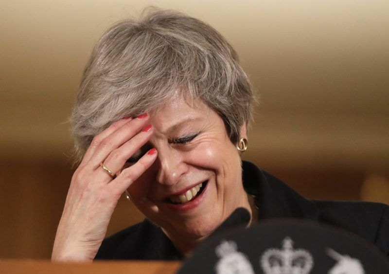 Britain's Prime Minister Theresa May reacts during a press conference inside 10 Downing Street in central London on November 15, 2018. - British Prime Minister Theresa May battled against a rebellion over her draft Brexit deal on Thursday, as ministers resigned and members of her own party plotted to oust her. (Photo by Matt Dunham / POOL / AFP)
