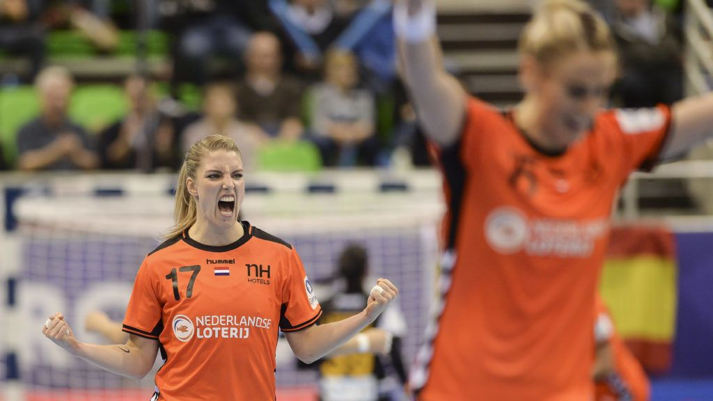 Netherlands' centre back Nycke Groot (L) celebrates during the Women Euro 2018 handball Championships group C preliminary round match between Spain and Netherlands on December 3, 2018 at the Axone arena in Montbeliard. (Photo by SEBASTIEN BOZON / AFP)