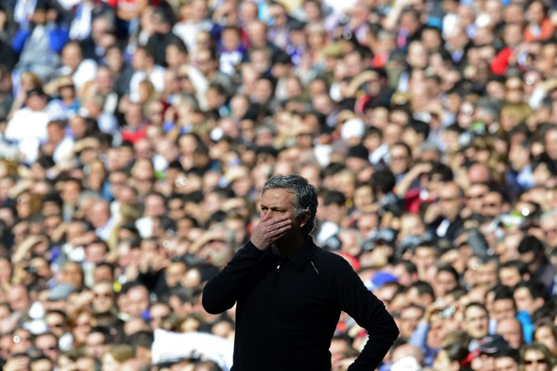 """Real Madrid's Portuguese coach Jose Mourinho reacts during the """"El clasico"""" Spanish League football match Real Madrid vs Barcelona at the Santiago Bernabeu stadium in Madrid on March 2, 2013.    AFP PHOTO/ JAVIER SORIANO (Photo by JAVIER SORIANO / AFP)"""