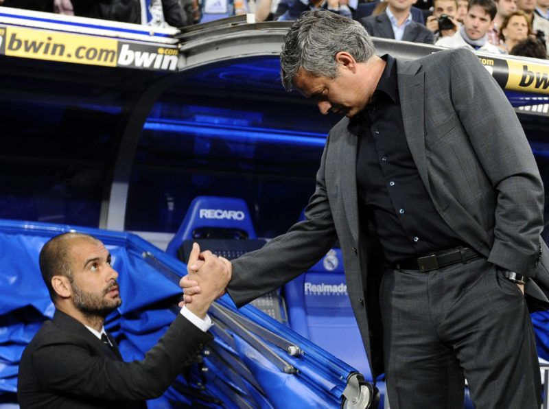"""Real Madrid's Portuguese coach Jose Mourinho (R) shakes hands with Barcelona's coach Josep Guardiola before """" El Clasico"""" Spanish League football match Real Madrid against Barcelona at the Santiago Bernabeu stadium in Madrid, on April 16, 2011. AFP PHOTO/JAVIER SORIANO. (Photo by JAVIER SORIANO / AFP)"""