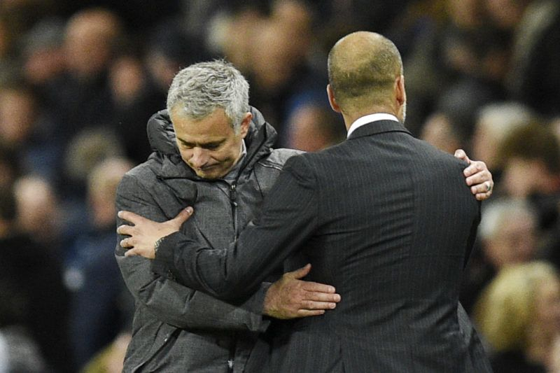 Manchester United's Portuguese manager Jose Mourinho (L) embraces Manchester City's Spanish manager Pep Guardiola (R) on the touchline at the end of the English Premier League football match between Manchester City and Manchester United at the Etihad Stadium in Manchester, north west England, on April 27, 2017. (Photo by Oli SCARFF / AFP) / RESTRICTED TO EDITORIAL USE. No use with unauthorized audio, video, data, fixture lists, club/league logos or 'live' services. Online in-match use limited to 75 images, no video emulation. No use in betting, games or single club/league/player publications. /
