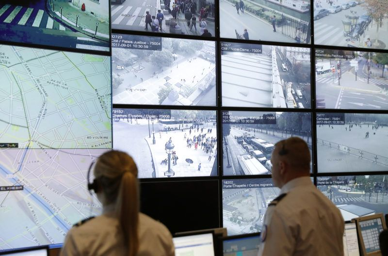 Police officers monitor control screens in the command room of public order and traffic at the Paris Police Prefecture, on September 1, 2017 in Paris. (Photo by PATRICK KOVARIK / AFP)