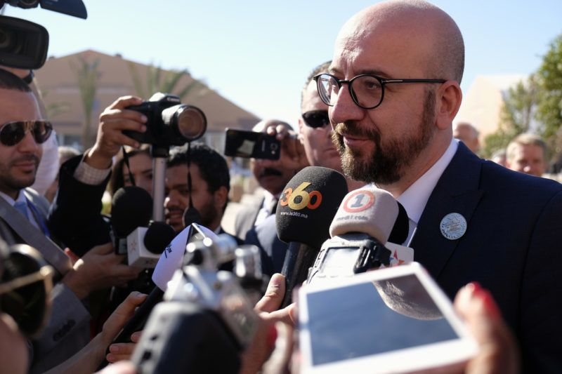 Belgian Prime Minister Charles Michel, with a pin of the Compact on his lapel, talks to the press after his speech at the global compact on migration conference, organised by the United Nations (UN), in Marrakesh, Morocco, Monday 10 December 2018. The Compact is the first intergovernmentally negotiated agreement to cover all dimensions of international migration. There was a political crisis in Belgium because of that pact, the Flemish nationalist members of the government resigned and the Prime Minister received the back up of the parliament to sign the pact. BELGA PHOTO ERIC LALMAND