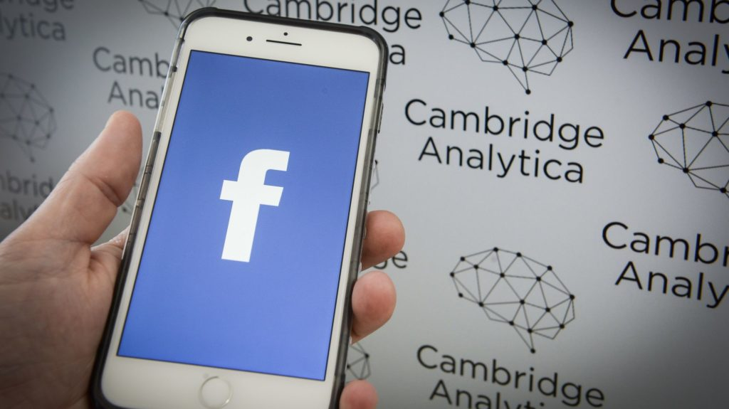 The now defunct Cambridge Analytica data mining and political consultancy company logo is seen with the Facebook application on a mobile device in this photo illustration on May 7, 2018. (Photo by Jaap Arriens/NurPhoto)