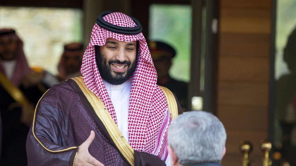 """A handout picture provided by the Saudi Royal Palace on December 3, 2018  shows Saudi Crown Prince Mohammed bin Salman shaking hands with Algerian Prime Minister Ahmed Ouyahia (R) upon his arrival in Algiers the previous day. (Photo by Bandar AL-JALOUD / Saudi Royal Palace / AFP) / XGTY / RESTRICTED TO EDITORIAL USE - MANDATORY CREDIT """"AFP PHOTO / SAUDI ROYAL PALACE / BANDAR AL-JALOUD"""" - NO MARKETING - NO ADVERTISING CAMPAIGNS - DISTRIBUTED AS A SERVICE TO CLIENTS"""