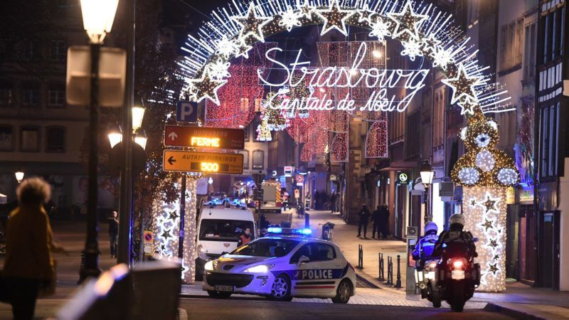 A police car drives in the streets of Strasbourg, eastern France, after a shooting breakout, on December 11, 2018. - A shooting in Strasbourg made one death and ten blessings, according to a new balance sheet. (Photo by Frederick FLORIN / AFP)