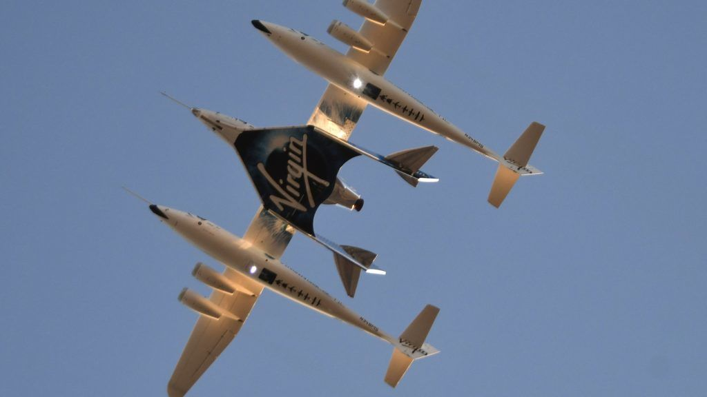Virgin Galactic's SpaceshipTwo takes off for a suborbital test flight of the VSS Unity on December 13, 2018, in Mojave, California. - Virgin Galactic marked a major milestone on Thursday as Unity made it to a peak height, or apogee, of 51.4 miles (82.7 kilometers), after taking off attached to an airplane from Mojave, California, then firing its rocket motors to reach new heights. (Photo by Gene Blevins / AFP)