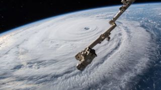 """(FILES) In this file photo taken on September 12, 2018, a high definition camera outside the International Space Station captures a NASA view of Hurricane Florence, shown in this video still taken as Florence churned across the Atlantic in a west-northwesterly direction with winds of 130 miles an hour. - US President Donald Trump on Tuesday, December 18, 2018 ordered the creation of """"Space Command,"""" a new organizational structure within the Pentagon that will have overall control of military space operations. The command will be separate from Trump's goal to build an entirely new branch of the military called """"Space Force,"""" which has not received approval from Congress. (Photo by HO / NASA / AFP) / RESTRICTED TO EDITORIAL USE - MANDATORY CREDIT """"AFP PHOTO / NASA"""" - NO MARKETING NO ADVERTISING CAMPAIGNS - DISTRIBUTED AS A SERVICE TO CLIENTS"""