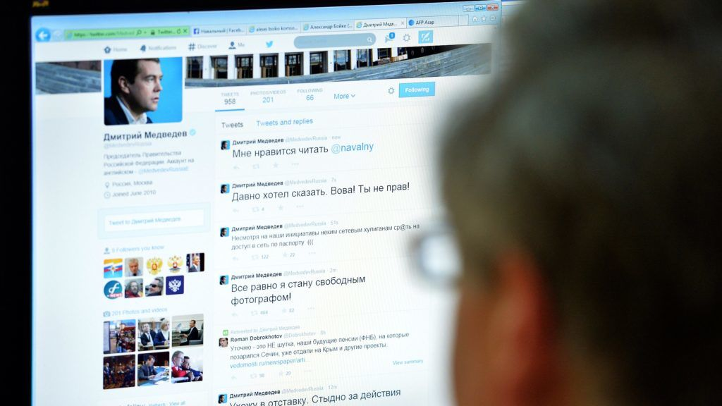 """A man looks at the computer screen with a page of Russian Prime Minister Dmitry Medvedev in Twitter in Moscow on August 14, 2014. Hackers broke into  Medvedev's Twitter account on Thursday, tweeting his resignation and criticising President Vladimir Putin. """"Microblog of the Premier in  """" Twitter """" hacked, recent reports are not true,"""" the press service of the Cabinet told Russian """"Interfax"""" news agency. AFP PHOTO / YURI KADOBNOV (Photo by YURI KADOBNOV / AFP)"""