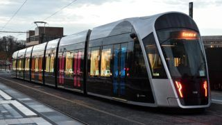 A tram of the Luxtram company, is pictured in a street of Luxembourg on November 24, 2017 ahead of its official inauguration on December 10, more than 60 years old after the tram service was removed in the city. (Photo by JOHN THYS / AFP)
