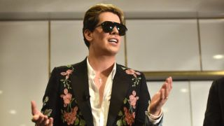 """Right-wing British provocateur Milo Yiannopoulos answers questions during a speech at Parliament House in Canberra on December 5, 2017. - Yiannopoulos blasted those who do not agree with him as """"petulant babies"""" after violent protests in Melbourne. The polarising former Breitbart editor is touring with his """"The Troll Academy"""" speaking show. Hundreds of protestors clashed with police and supporters of Yiannopoulos outside a supposedly secret venue in Melbourne on December 4. (Photo by MARK GRAHAM / AFP)"""