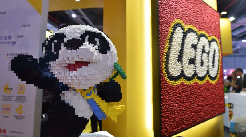 """View of the masterpiece mosaic of 112,031 Lego bricks featuring Jinbao, the mascot of the China International Import Expo, on display during the First China International Import Expo (CIIE 2018) in Shanghai, China, 6 November 2018.  The masterpiece mosaic of 112,031 Lego bricks featuring Jinbao, the mascot of the China International Import Expo, at the Danish company's 378-square-meter booth at the Expo might alone has made it stand out as one of the most noticeable exhibits. But it is with the exclusive launch of two sets of Spring Festival-themed products that the toymaker hopes to further penetrate into the country, one of its fastest growing markets, in which it has been selling its iconic bricks for 35 years. """"This is the first time we've made sets for a specific country or region,"""" Niels B. Christiansen, chief executive officer of the Lego Group, said at the launch event during the CIIE in Shanghai. """"If you measure it by turnover, the United States is the biggest toy market in the world, as well as for Lego. But if you look forward, the potential, the opportunity and growth rates in China are amazing. So if you look at growth potential, China is the most important market,"""" he added. In March, the company reported its first sales decline in 13 years in its 2017 financial report. Its revenue fell by 7 percent from 37.9 billion Danish crowns ($5.77 billion) in 2016 to 35 billion Danish crowns. However, China continued to post double-digit growth, as the report showed, but failed to give a specific rate."""