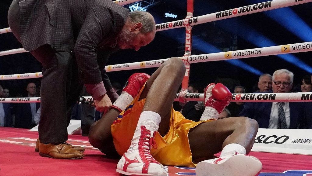 QUEBEC CITY, QC - DECEMBER 1: Adonis Stevenson (gold trunk) is being checked out by Marc Gagne after being knocked out by Oleksandr Gvosdyk during their WBC light heavyweight championship fight at the Videotron Center on December 1, 2018 in Quebec City, Quebec, Canada.   Mathieu Belanger/Getty Images/AFP