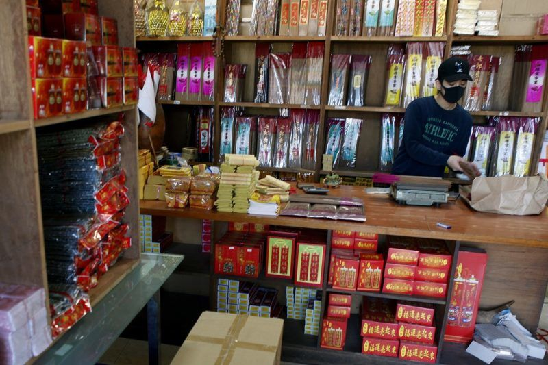 Lin Chin-hsiang, the young man who damaged three Ferraris in a single crash, works at his family's shop selling incense and gold paper money in Taipei on December 20, 2018. - An exhausted Taiwanese delivery driver who smashed into three Ferraris has been inundated with donations after his plight and eye-watering repair bill sparked a deluge of public sympathy. (Photo by HSU Tsun-hsu / AFP)