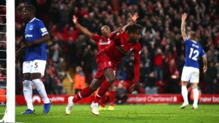 LIVERPOOL, ENGLAND - DECEMBER 02:  Divock Origi of Liverpool celebrates after scoring his team's first goal during the Premier League match between Liverpool FC and Everton FC at Anfield on December 2, 2018 in Liverpool, United Kingdom.  (Photo by Clive Brunskill/Getty Images)