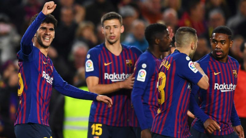 BARCELONA, SPAIN - DECEMBER 02:  Carles Alena of Barcelona (L) celebrates as he scores his team's second goal with team mates during the La Liga match between FC Barcelona and Villarreal CF at Camp Nou on December 2, 2018 in Barcelona, Spain.  (Photo by David Ramos/Getty Images)