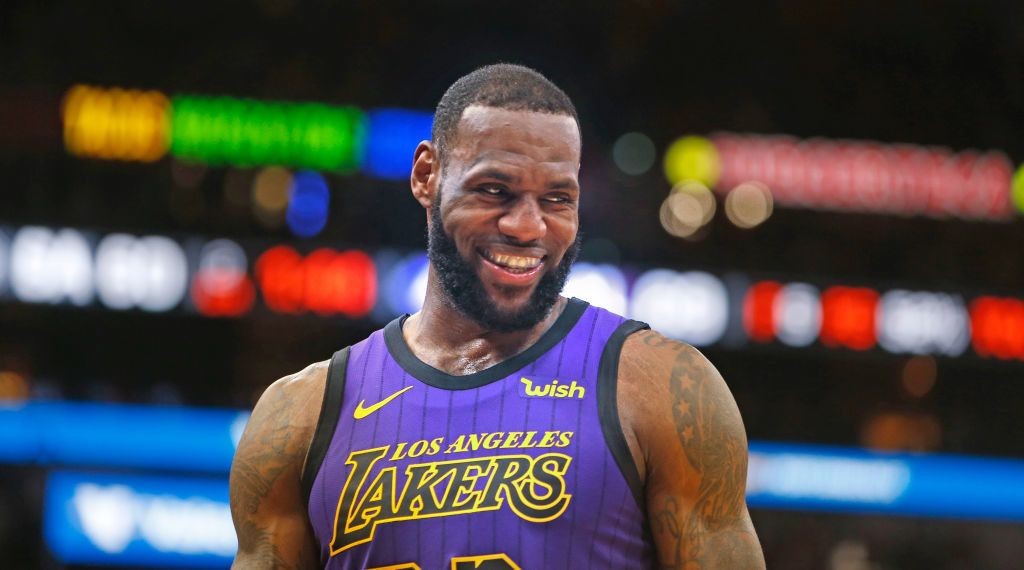 SAN ANTONIO, TX - DECEMBER 7: LeBron James #23 of the Los Angeles Lakers is all smiles as San Antonio Spurs fans cheered him on at AT&T Center on December 7 , 2018 in San Antonio, Texas.  NOTE TO USER: User expressly acknowledges and agrees that , by downloading and or using this photograph, User is consenting to the terms and conditions of the Getty Images License Agreement. (Photo by Ronald Cortes/Getty Images)
