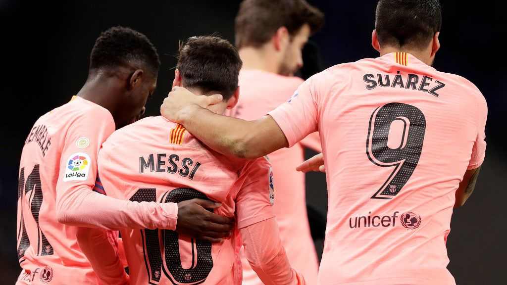 CORNELLA, SPAIN - DECEMBER 8: Lionel Messi of FC Barcelona celebrates with Ousmane Dembele of FC Barcelona, Luis Suarez of FC Barcelona  during the La Liga Santander  match between Espanyol v FC Barcelona at the RCDE Stadium on December 8, 2018 in Cornella Spain (Photo by Jeroen Meuwsen/Soccrates/Getty Images)