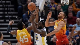 SALT LAKE CITY, UT - DECEMBER 19: Draymond Green #23 of the Golden State Warriors blocks the shot by Donovan Mitchell #45 of the Utah Jazz in the first half of a NBA game at Vivint Smart Home Arena on December 19, 2018 in Salt Lake City, Utah. NOTE TO USER: User expressly acknowledges and agrees that, by downloading and or using this photograph, User is consenting to the terms and conditions of the Getty Images License Agreement. (Photo by Gene Sweeney Jr./Getty Images)