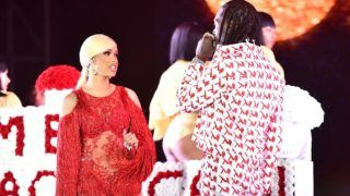 LOS ANGELES, CALIFORNIA - DECEMBER 15: Singer Cardi B is presented a 'Take Me Back' card onstage by Offset during day 2 of the Rolling Loud Festival at Banc of California Stadium on December 15, 2018 in Los Angeles, California. (Photo by Scott Dudelson/Getty Images)