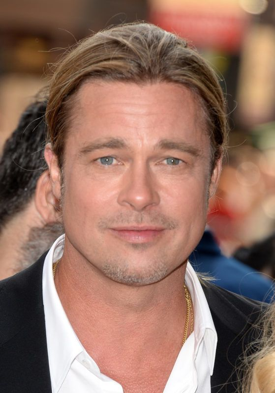 """TORONTO, ON - SEPTEMBER 06:  Actor/ producer Brad Pitt arrives at the """"12 Years A Slave"""" Premiere during the 2013 Toronto International Film Festival at Princess of Wales Theatre on September 6, 2013 in Toronto, Canada.  (Photo by Jason Merritt/Getty Images)"""