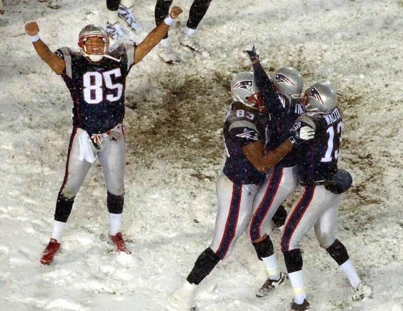 FOXBOROUGH, MA - JANUARY 19: Patriots kicker Adam Vinatieri is lifted in the air by his teammates as Jemaine Wiggins celebrates after defeating the Raiders 16-13 in overtime. New England Patriots face the Oakland Raiders in an AFC playoff game at Foxboro Stadium in Foxborough, MA on Jan. 19, 2002. (Photo by Matthew J. Lee/The Boston Globe via Getty Images)