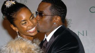 """Kim Porter and Sean """"P. Diddy"""" Combs (Photo by Lawrence Lucier/FilmMagic)"""