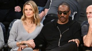 LOS ANGELES, CA - APRIL 08:  Actor Eddie Murphy and actress Paige Butcher attend a basketball game between the Los Angeles Lakers and the Utah Jazz at Staples Center on April 8, 2018 in Los Angeles, California.  (Photo by Allen Berezovsky/Getty Images)