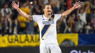 CARSON, CA - JUNE 9: Zlatan Ibrahimovic #9 of Los Angeles Galaxy celebrates his second goal of the game as Justen Glad #15 of Real Salt Lake tries to defend during the Los Angeles Galaxy's MLS match against FC Dallas at the StubHub Center on June 9, 2018 in Carson, California. Los Angeles Galaxy won the match 3-0 (Photo by Shaun Clark/Getty Images)
