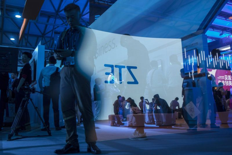The ZTE Corp. logo projected on a screen is reflected on a pane of glass at the Ericsson AB booth at the Mobile World Congress Shanghai in Shanghai, China, on Thursday, June 28, 2018. The exhibition runs through June 29. Photographer: Qilai Shen/Bloomberg via Getty Images