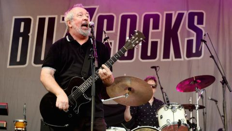MANCHESTER, ENGLAND - JULY 06:  Pete Shelley of Buzzcocks performs during Sounds of the City at Castlefield Bowl on July 6, 2018 in Manchester, England.  (Photo by Shirlaine Forrest/WireImage)