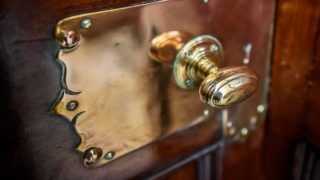 An antique traditional luxurious brass door handle.