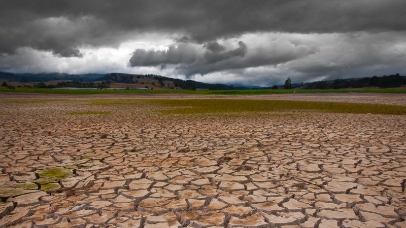 Drought land with dense cloudy pattern, apparently rain is about to happen.